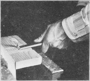 Fig. 70. Chiseling Out a Dado. (First Step).