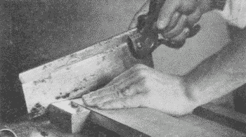 Fig. 90. Using the Back-Saw with Bench-Hook.