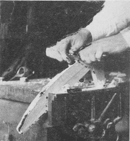 Fig. 120. Using a Spokeshave.