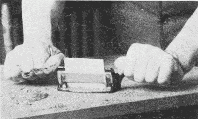 Fig. 151. Using a Veneer-Scraper.