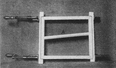 Fig. 253. Gluing Together a Picture-Frame (See also Fig. 254.)