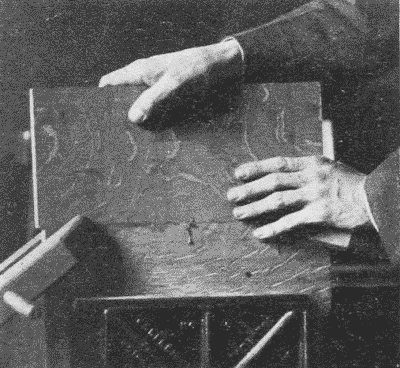 Fig. 261. Rubbing a Glued Joint.