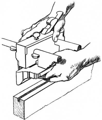 Fig. 122.—Method of using the Plough Plane.