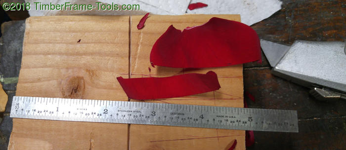 cutting strips of rose petal