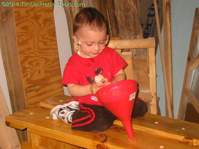 Child playing with a funnel