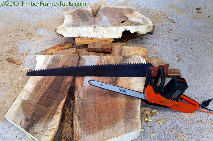 Hand saw and electric chain saw working together.