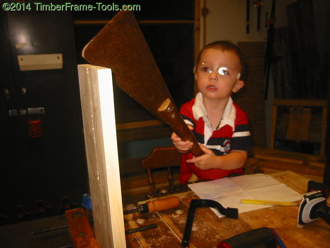 Child sawing.