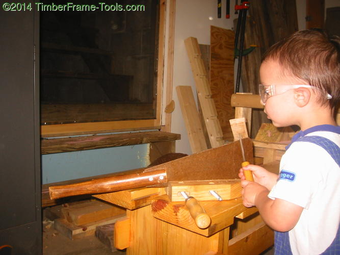 Child sharpening a saw.