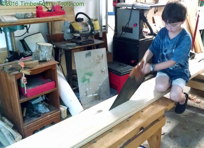 Child rip sawing.