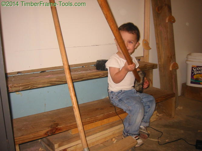 Child with sledge hammer