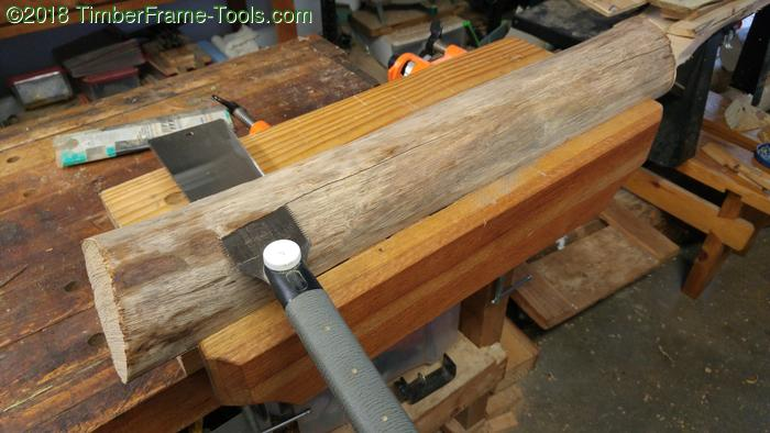 sawing a flat side on a log