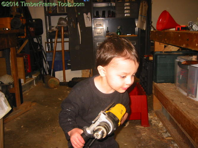 child with a dewalt drill