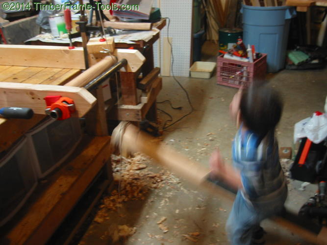 Child running lathe.