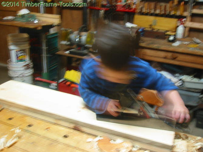 Kid with a jack plane.