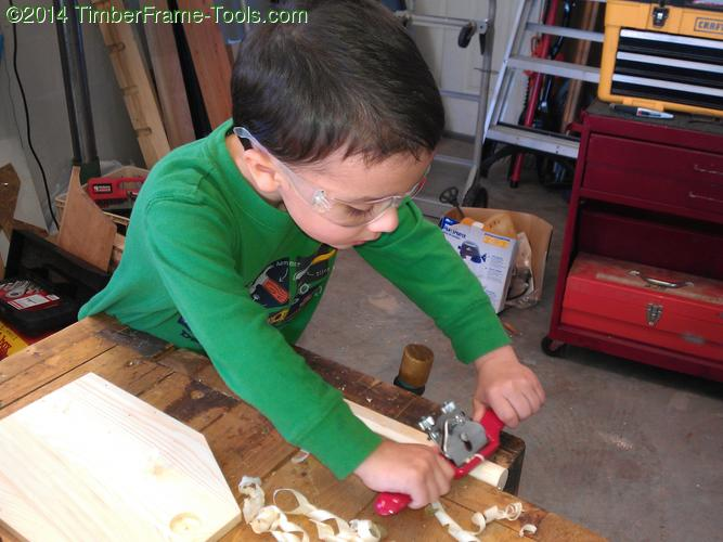 Child using spokeshave.