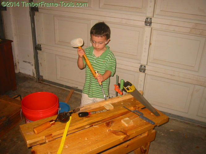 Kid with mallet.