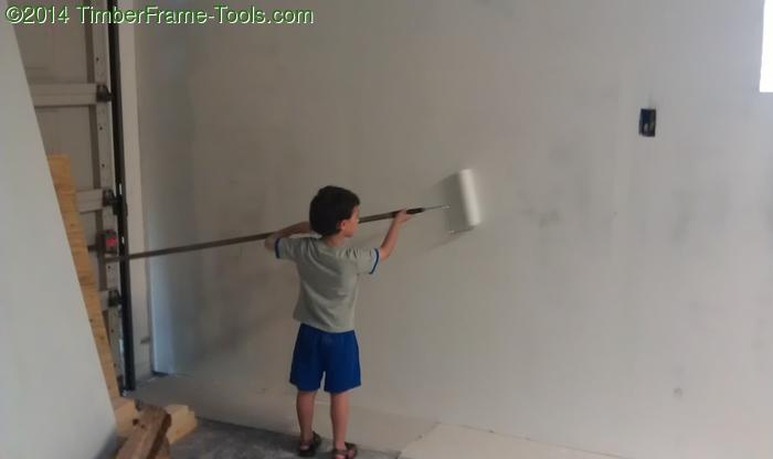 Child painting a wall.