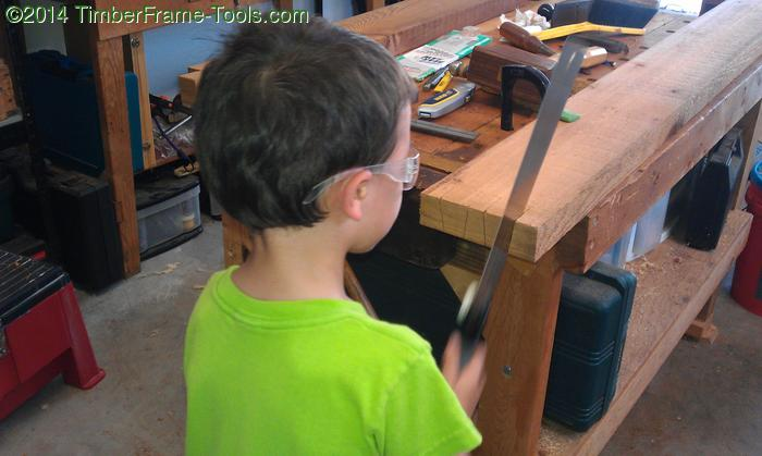Child sawing dovetails.