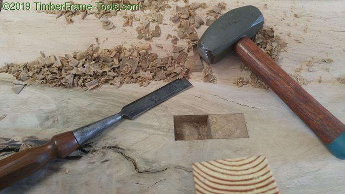 Chiseling with a lump hammer.