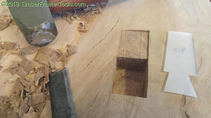 Cutting a pocket dovetail with a template.