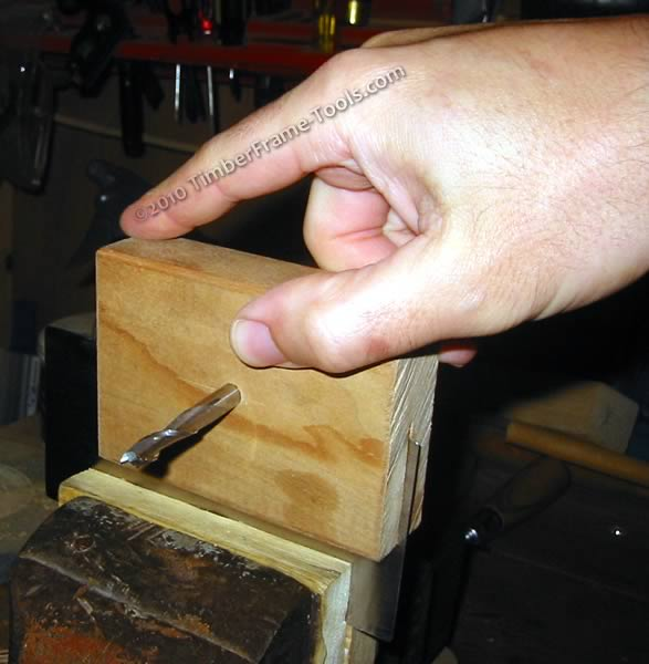 This jig is used for burnishing the edge of a card scraper.