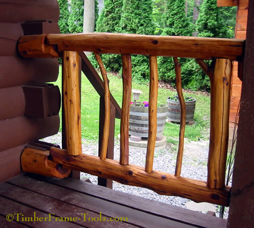 Cedar deck gate made from natural cedar logs and branches.