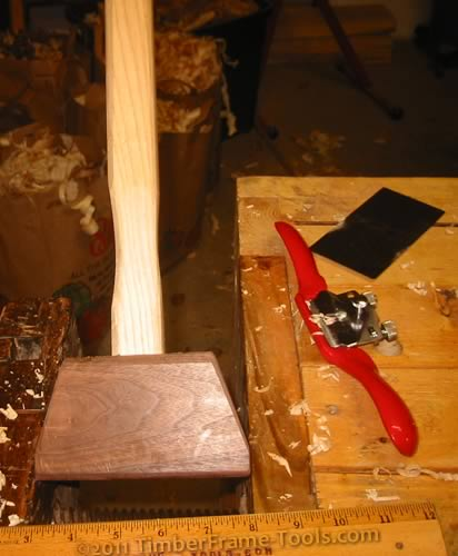 Contouring the handle with a spokeshave and card scraper